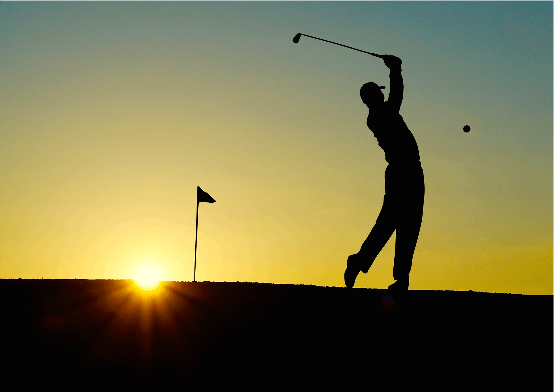 silhouette of man playing golf during sunset niche tourism